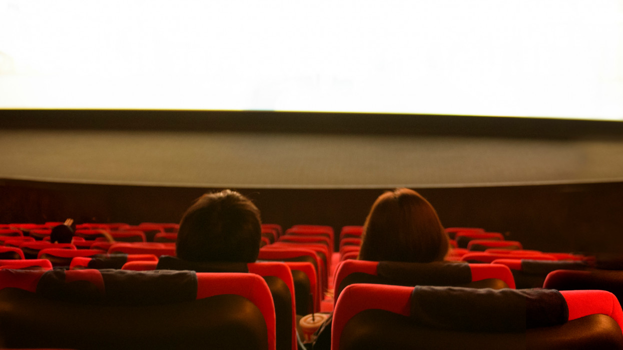 Happy Couple Watching Movies at the Movie Theater - Process Noise Effects