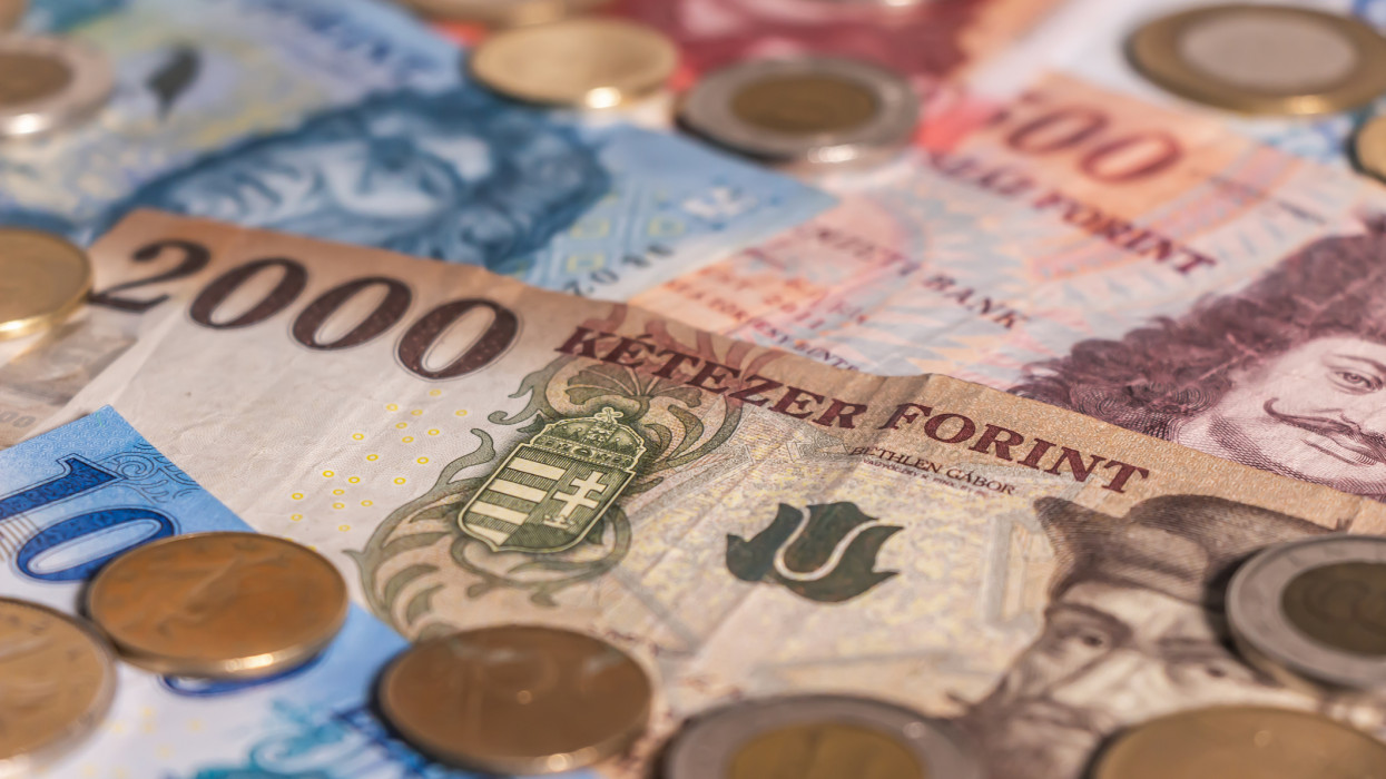 A composition of Hungarian forint. HUF banknotes and coins providing great options to be used for illustrating subjects as business, banking, media, presentations etc.