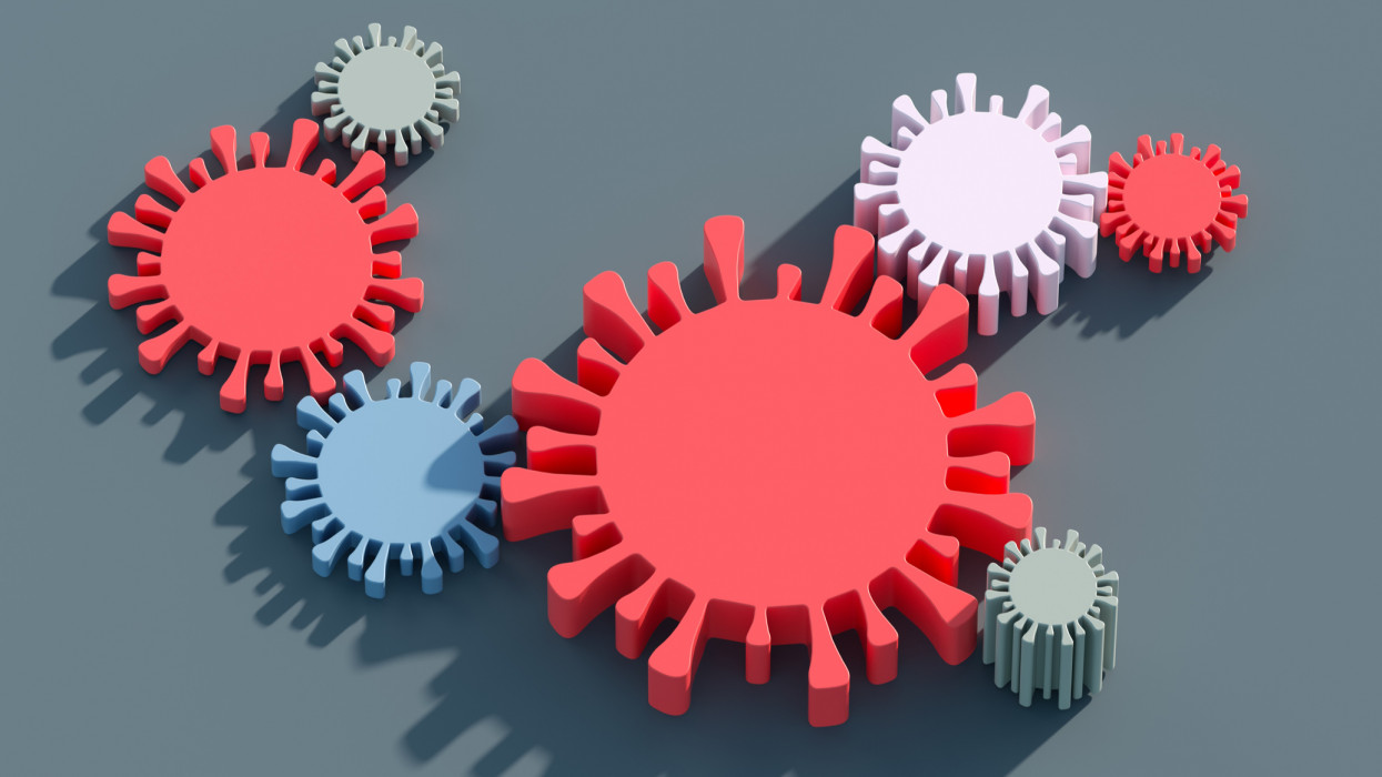 Digital generated image of cogs in shape of coronavirus interlocked on gray background
