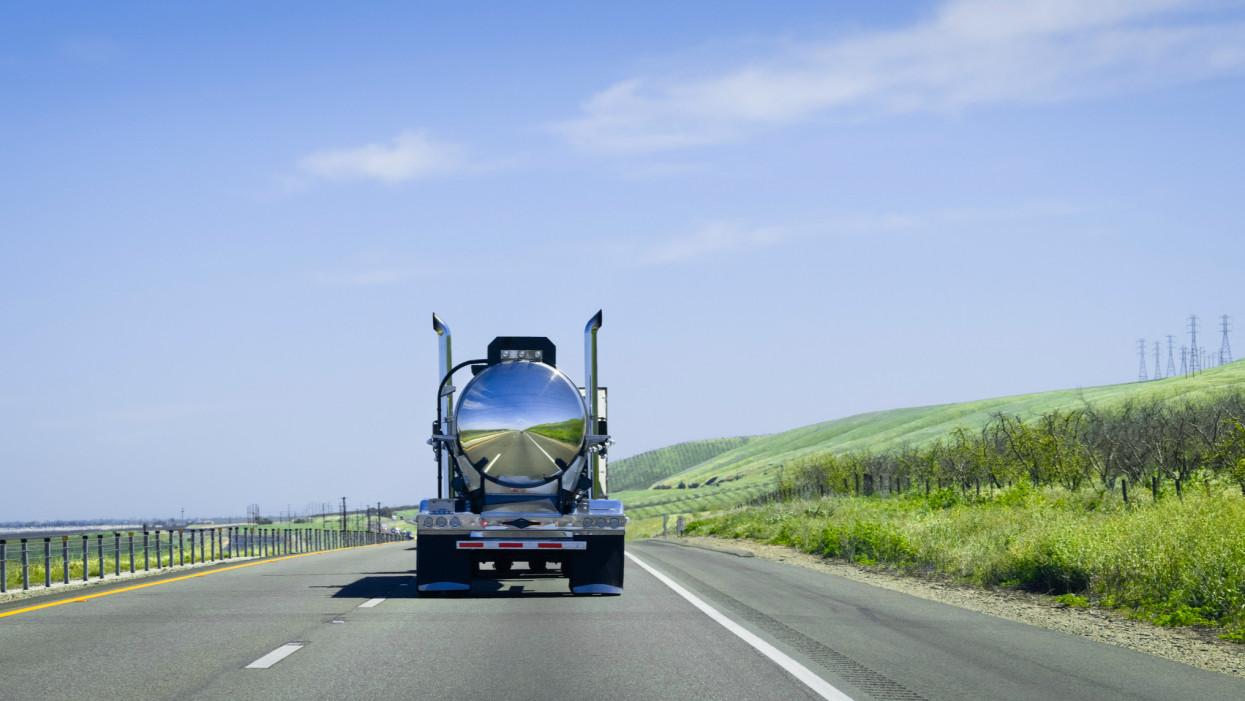 chrome tanker truck on freeway