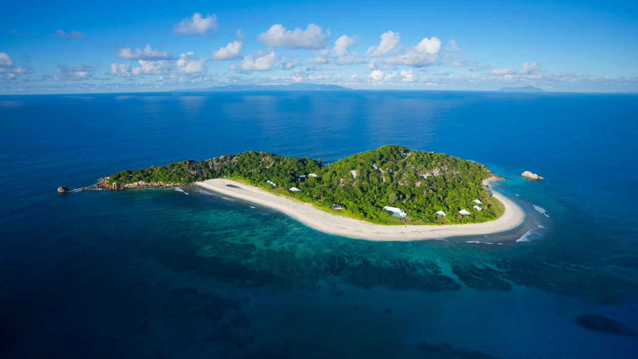 Aerial view of Cousine island showing beach and villas. Cousine island. Seychelles.(Property released)
