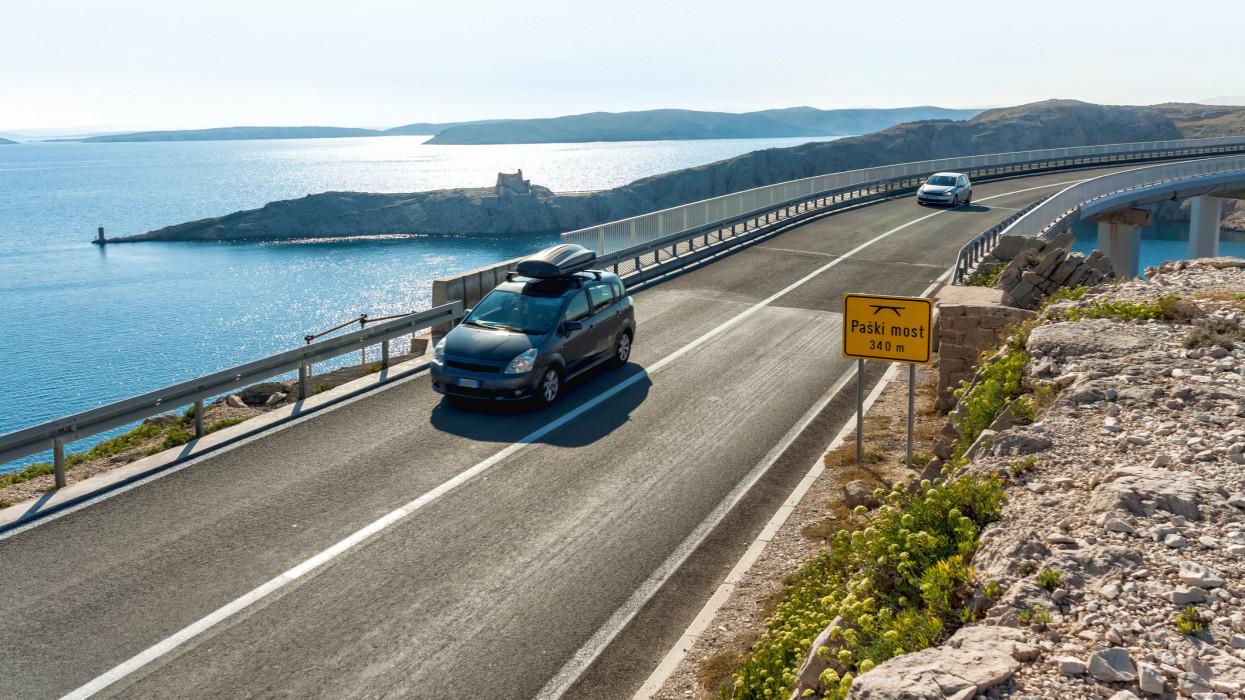 Passenger car passing Pag bridge (Paski most), Pag island, Croatia