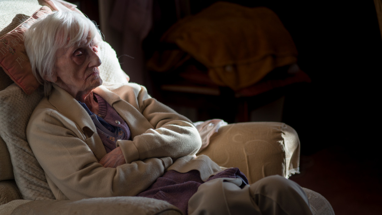 A ninety year old lady is covered in an insulating blanket to try and stay warm and is unable to leave her house unaided as she is registered blind and frail.
