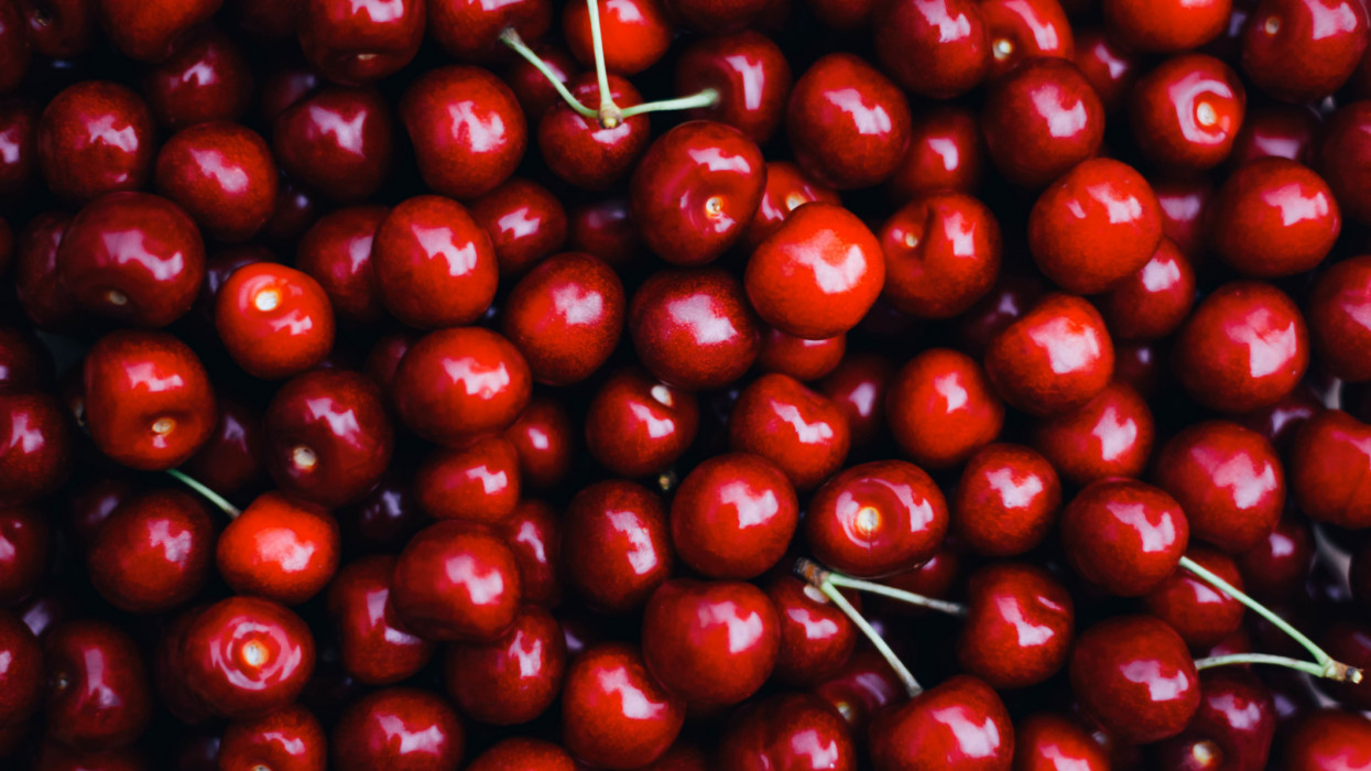 Background of fresh beautiful red cherries. Selective focus. Food.