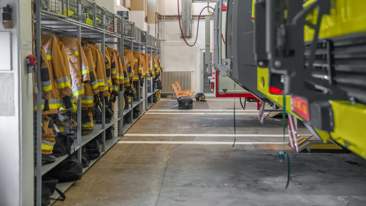 Firestation interior with vechicle and hanging cloth angle shot