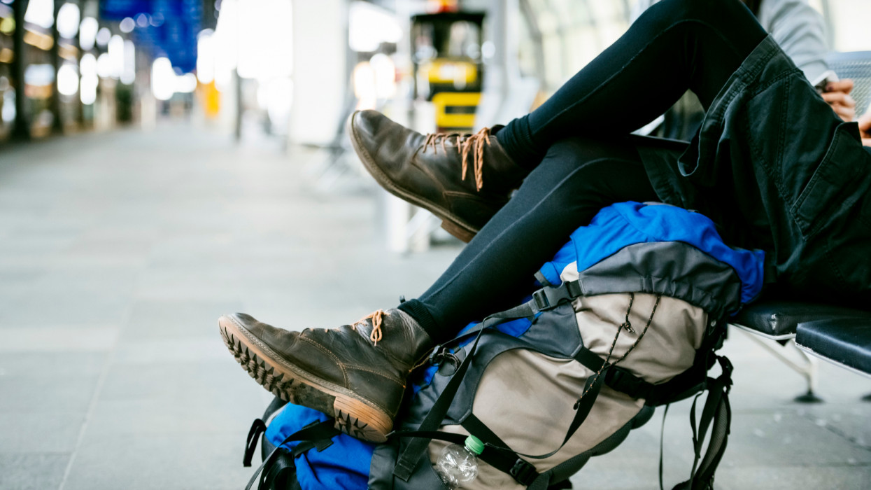 Closeup of young backpackers relaxing at the Airport