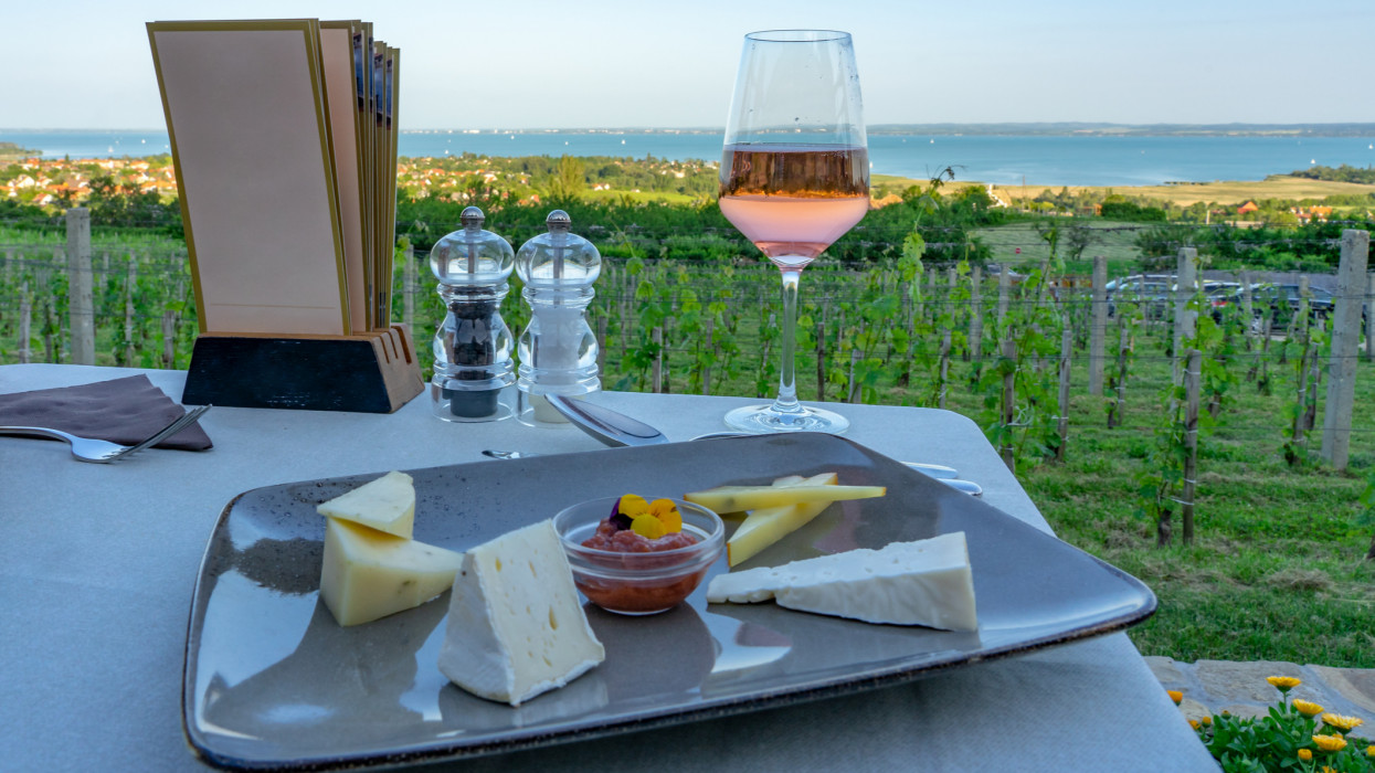 Wine, cheese table over the Lake Balaton on the hill Dinner, lunch, romantic date, picnic, eating on nature. Csopak wine restaurant in Hungary
