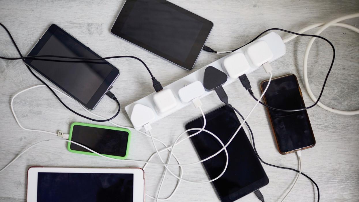 Digital tablets and mobile phones plugged in to an extension lead charge