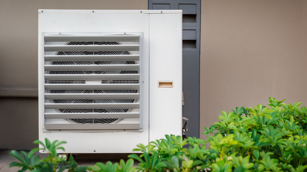 Condensing Fan Installing Outside Building Exterior of Air Conditioner.