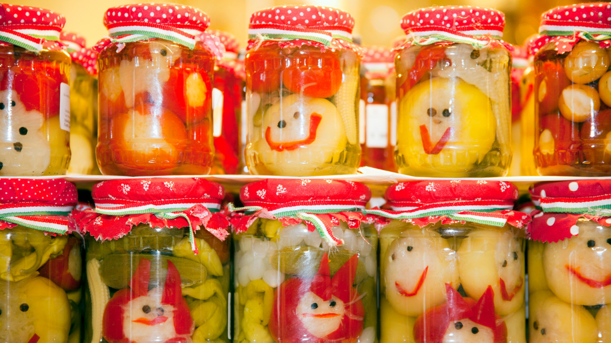 Funny jars of pickled vegetables on town market Budapes Hungary