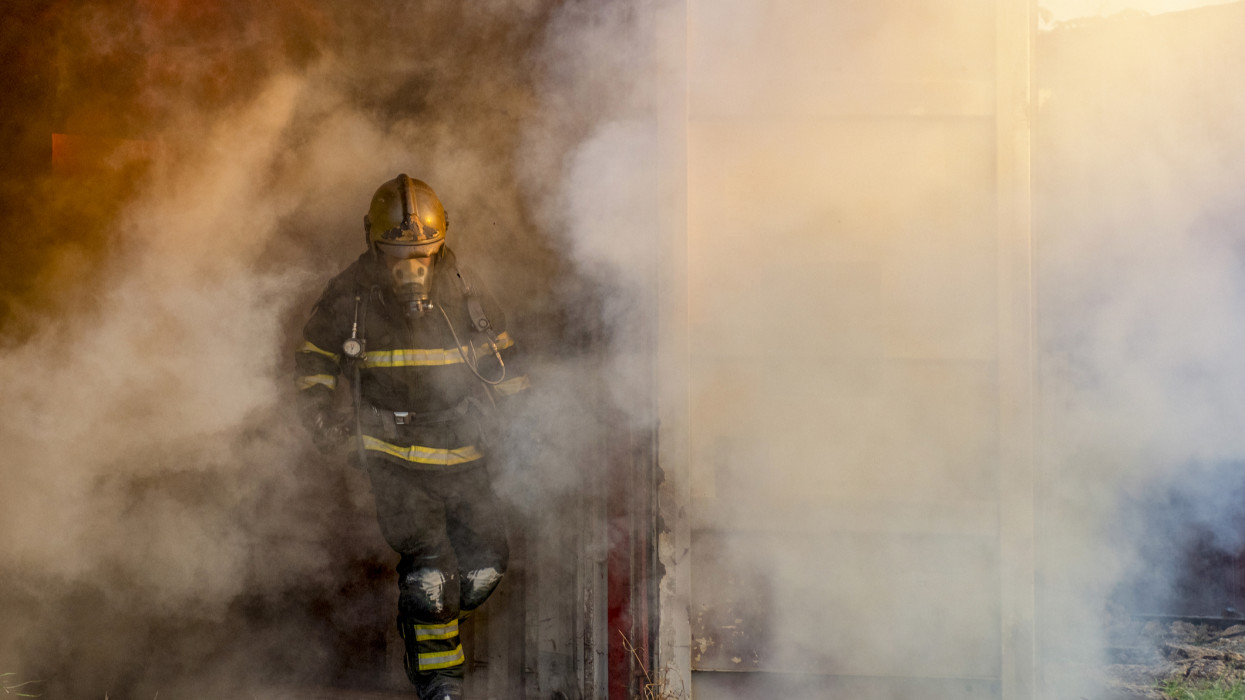 Firefighter in fire fighting operation.