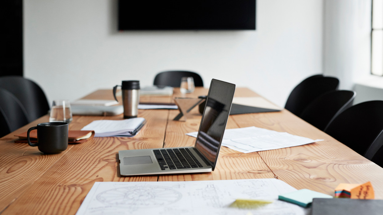 Laptop over conference table in board room at workplace
