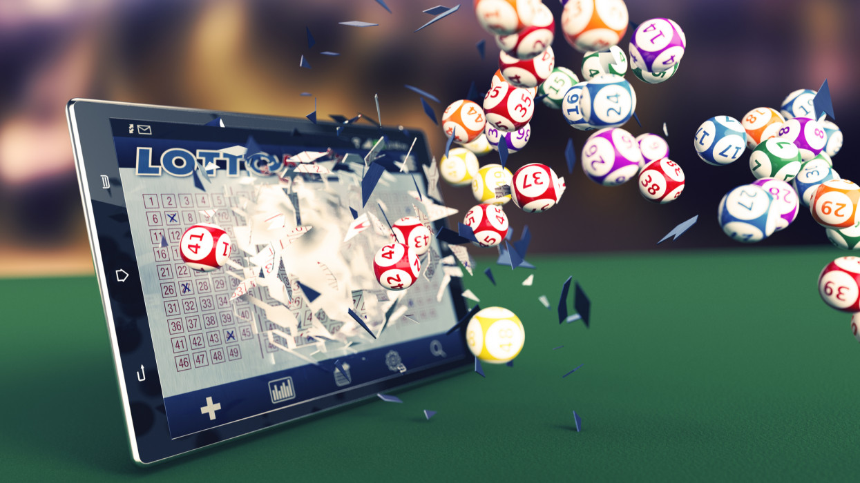 tablet pc with a lottery app and lottery balls coming out by breaking the glass (3d render)