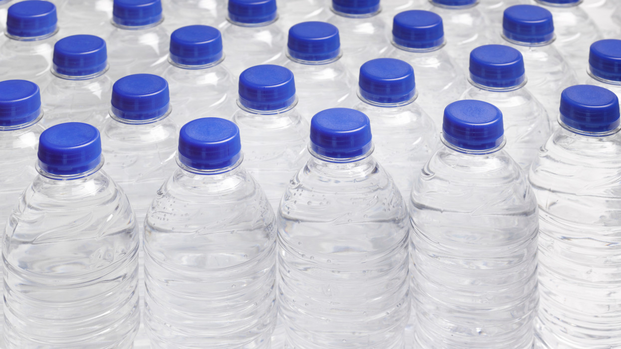 Full frame of still water bottles in rows