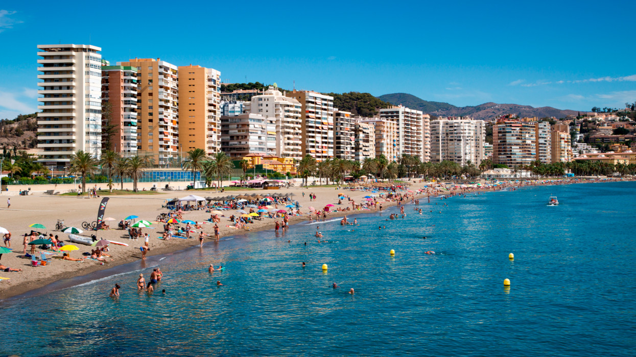 Playa de la Malagueta beach with high-rise apartment buildings, Malaga, Costa del Sol, Andalusia, Spain.