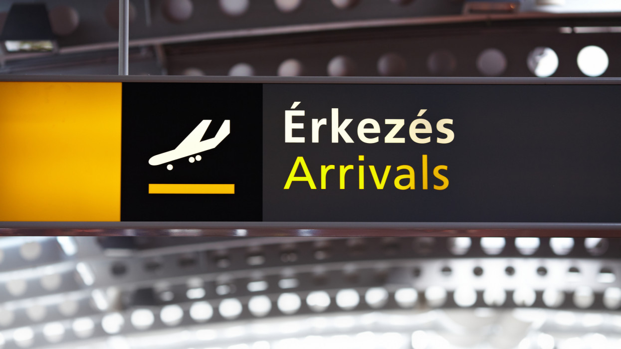 Arrivals airport sign in Hungary with Hungarian text
