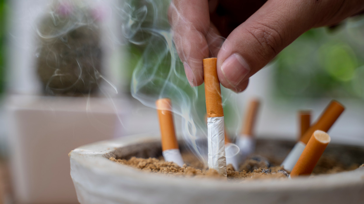 Close up on man Man extinguishes the cigarette in the ash tray quitting no smoking lung health problems