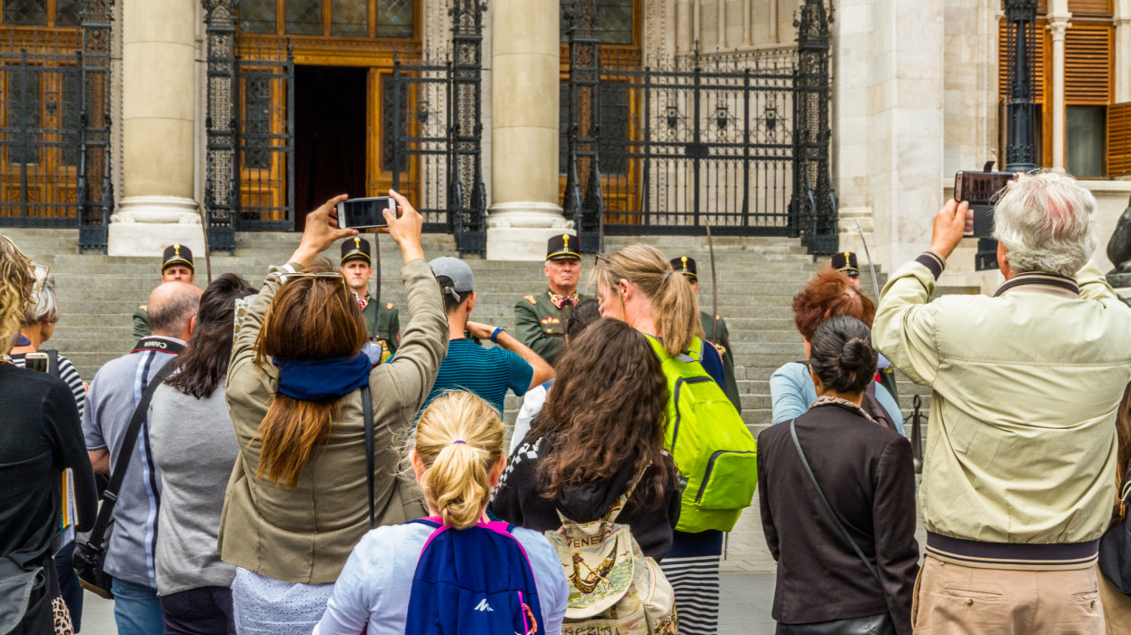 Budapest, Changing of the guard at the Hungarian Parliament Building, soldiers being photographed by tourists landscape, on September 17 2019 in Hungary