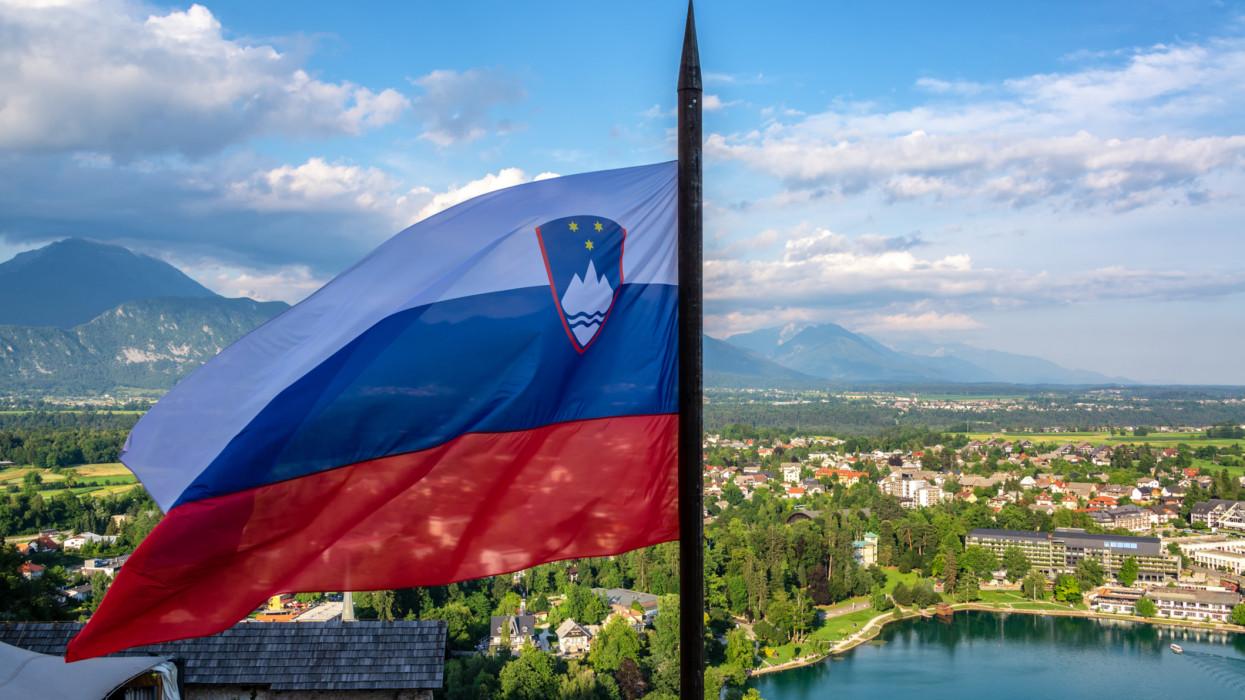 Slovenian flag flying high over Lake Bled in Slovenia