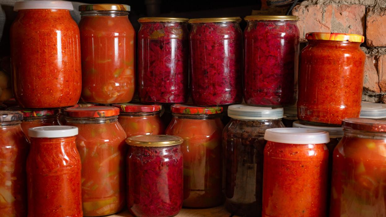 Canned vegetables in liter glass transparent jars.
