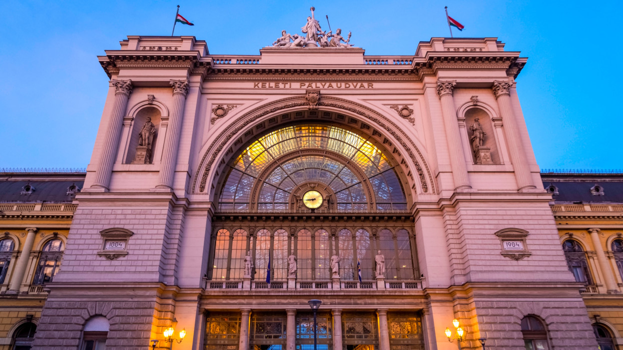 Budapest Keleti railway station (Keleti pályaudvar) is the main international and inter-city railway terminal in Budapest, Hungary. The building was designed in eclectic style. The main facade is decorated with two statues and the clock at front.
