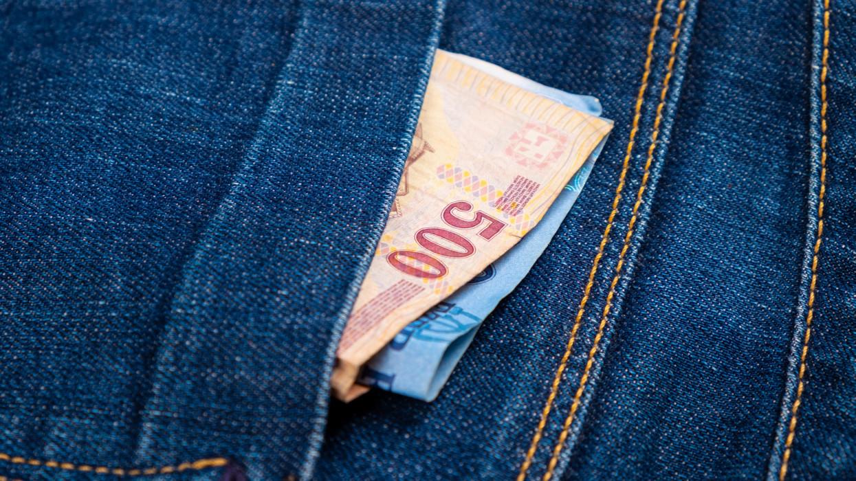 paper money in jeans pocket,forints cash closeup.