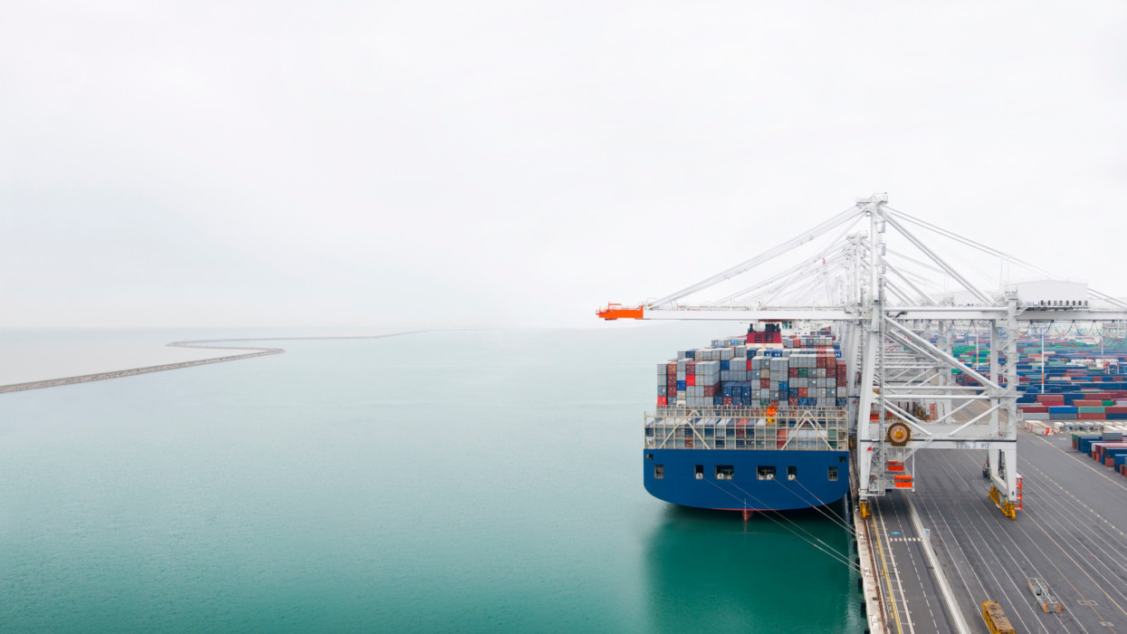 Containers ship in Havre port, aerial view