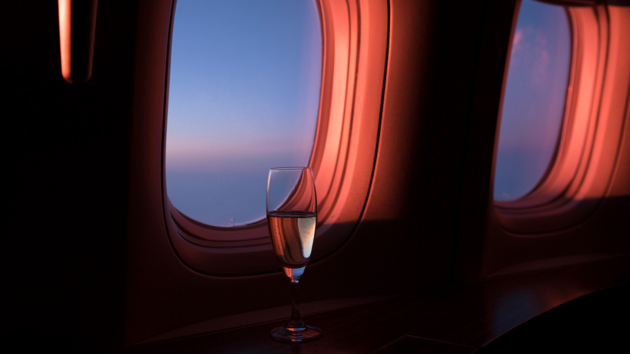 Sunset view from first class cabin windows with champagne glass.