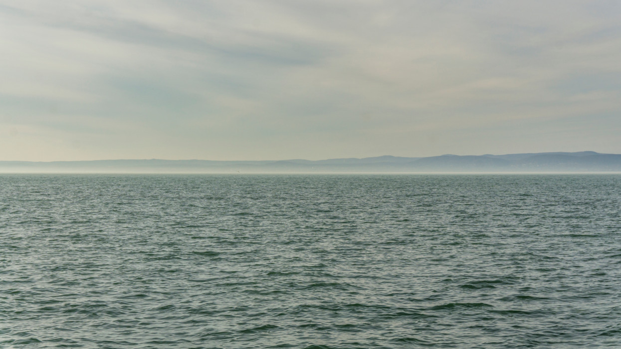 Lake Balaton with cloudy sky and waves, horizontal