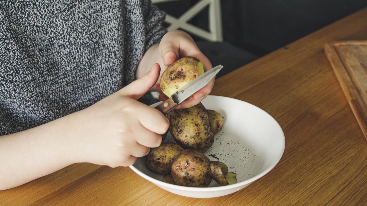 Peeling potatoes child table