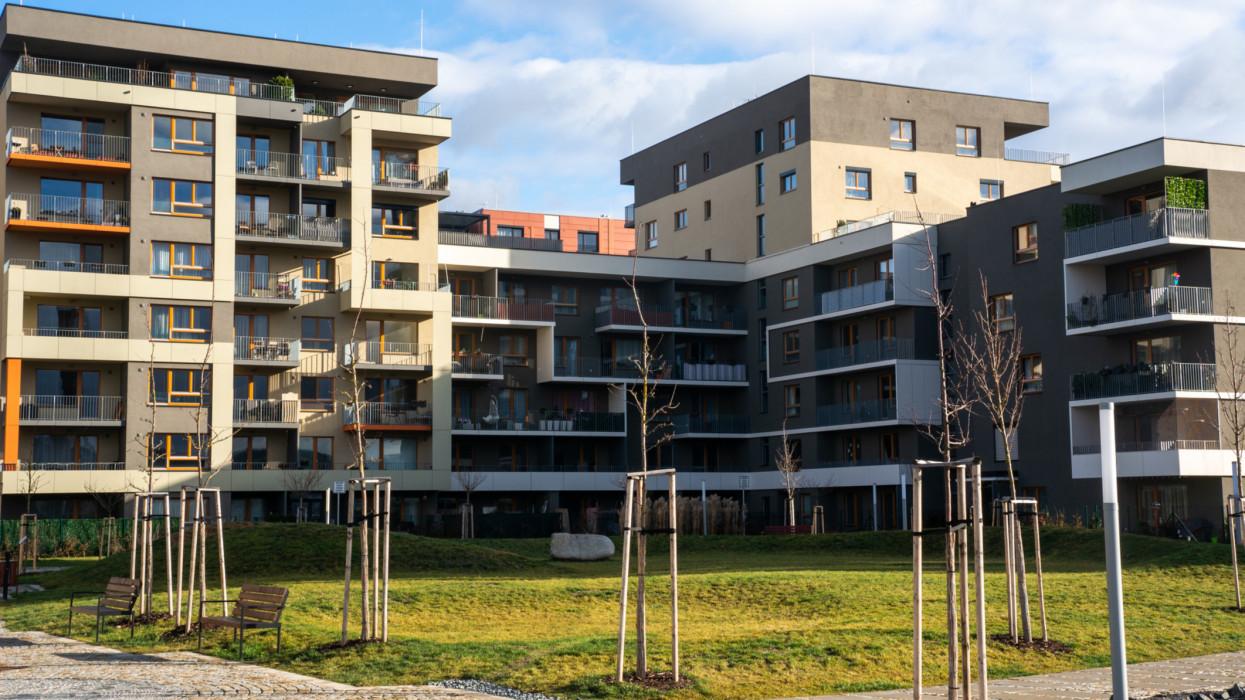 Cukrovar Modrany, Prague 12, Czech Republic - February 3 2020: Newly built apartment complex for families with park area