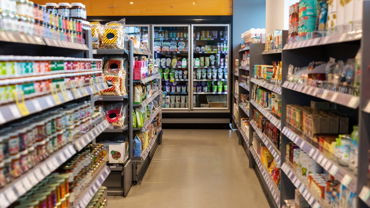 Shot of a supermarket aisles with variety of products on shelves. Grocery store with products in racks.