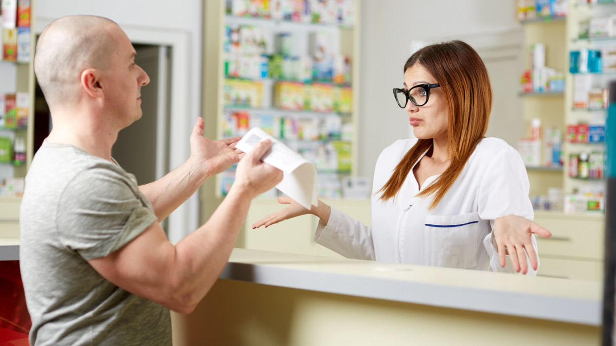 Angry client at a pharmacy showing the recipe to the pharmacist
