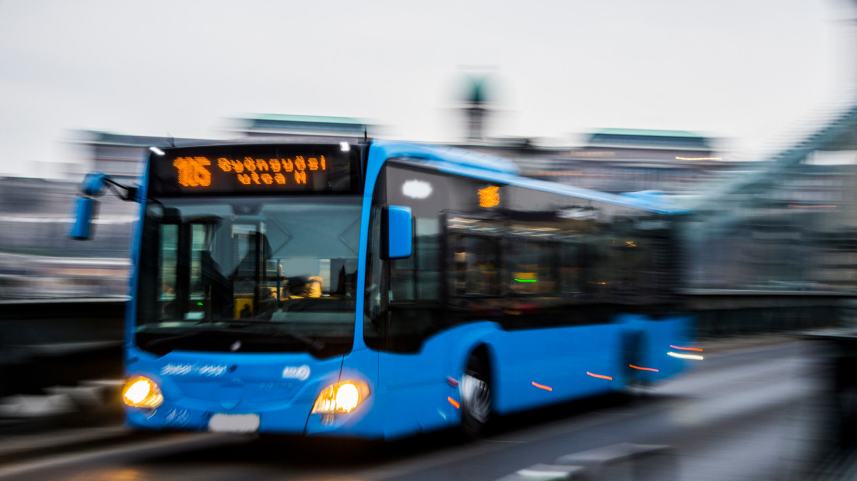 A budapest blue bus in motion