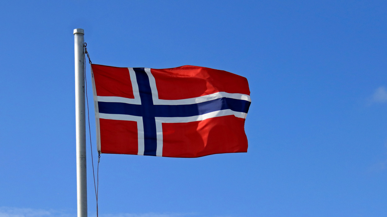 The flag of Norway is red with an indigo blue Scandinavian cross lined with white that extends to the edges of the flag. It was adopted on July 13, 1821.