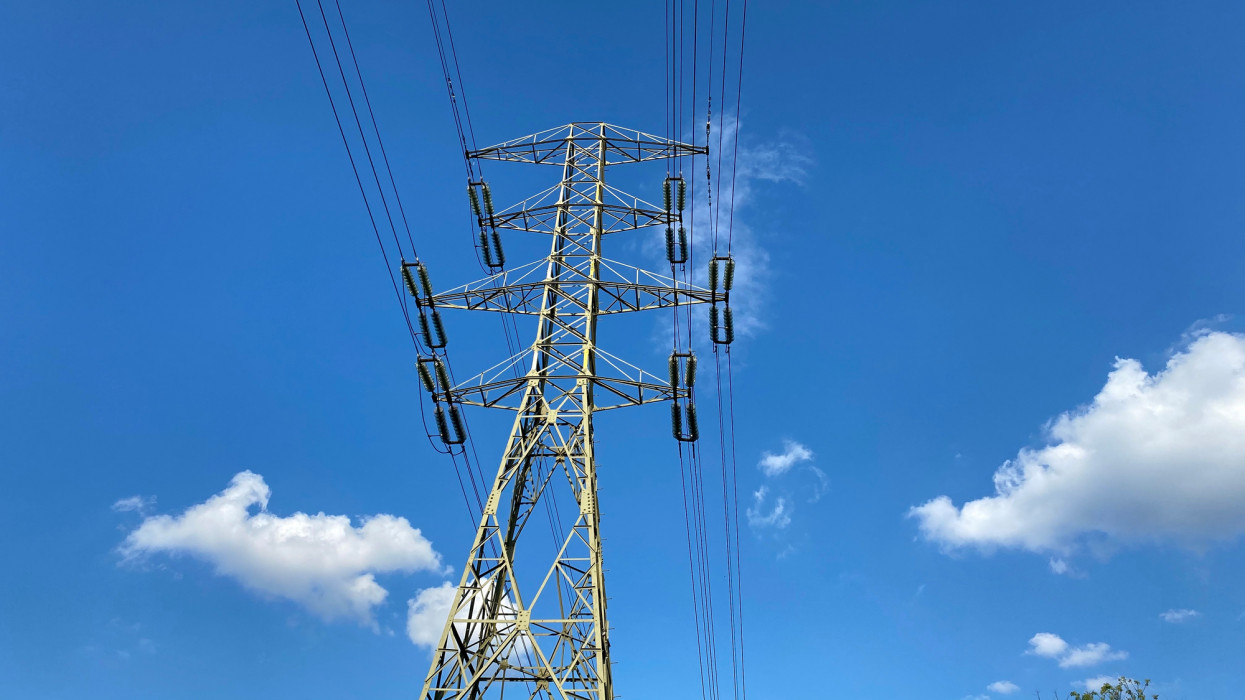 high voltage line and blue sky with clouds