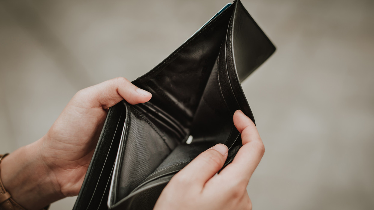 Hand open empty an wallet. Poor or personal financial problem concept.