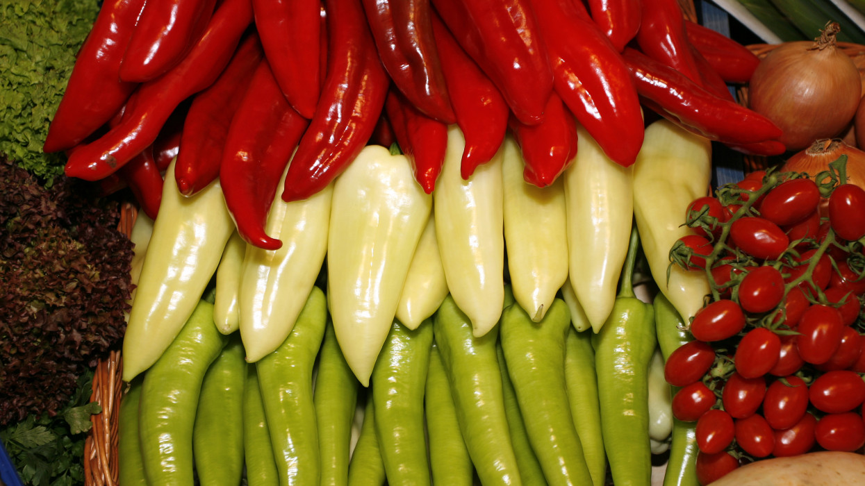 Red white and green peppers at a farmers market