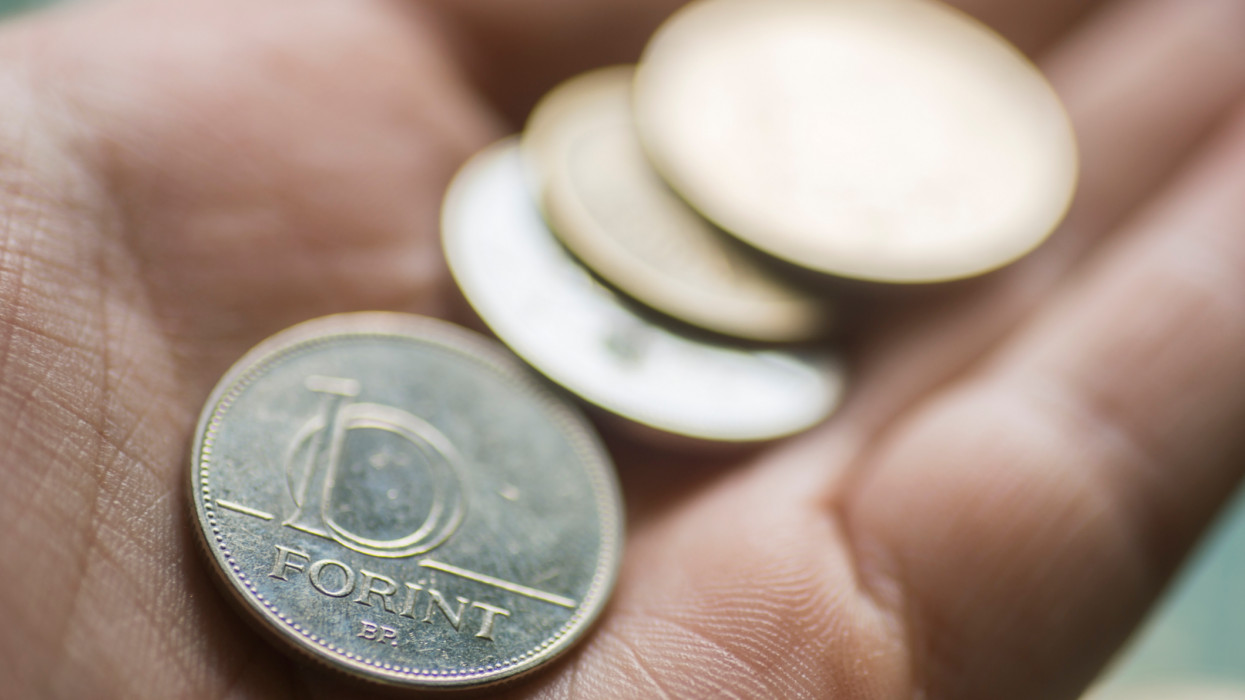 The hungarian currency (Forint) in a human hand. Hungary belongs to the European Union but hasnt adopted the euro as currency.