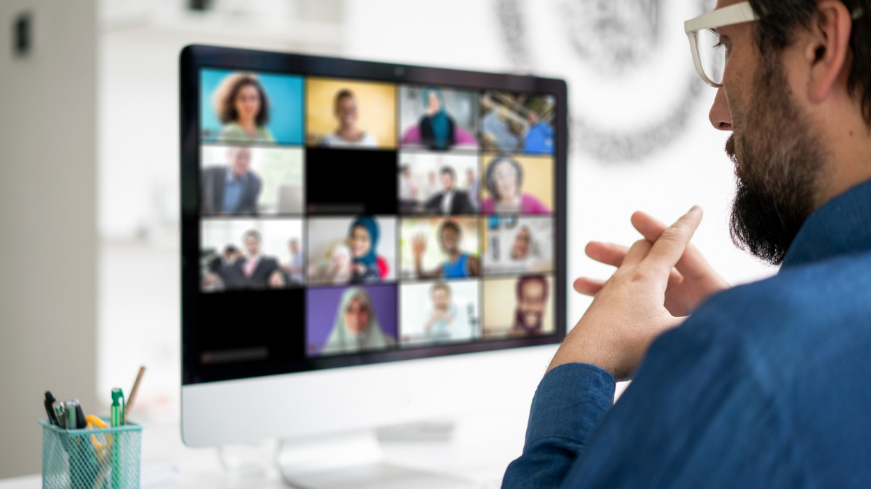 Working at home having a video conference with colleagues