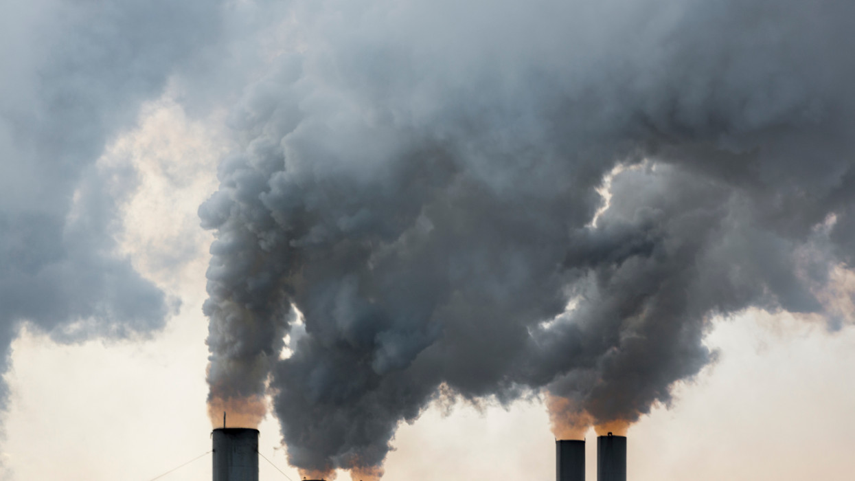 Plumes of smoke rise from chimneys at an industrial area in Greece. cimlapi