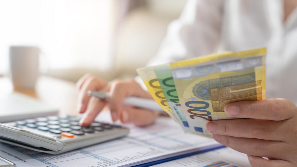 Woman accounting ,Money, euro