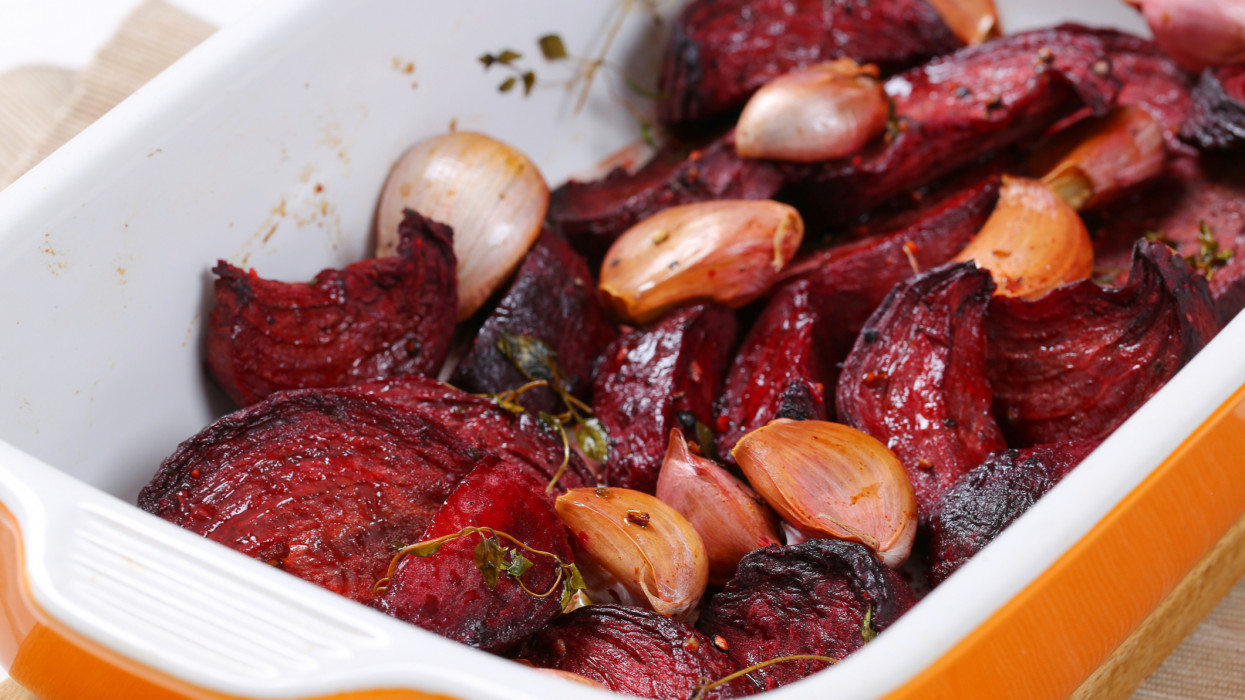 freshly baked beetroot with garlic in baking dish - close up