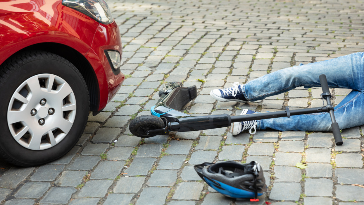 Man After Accident On Electric Scooter Overrun By Car