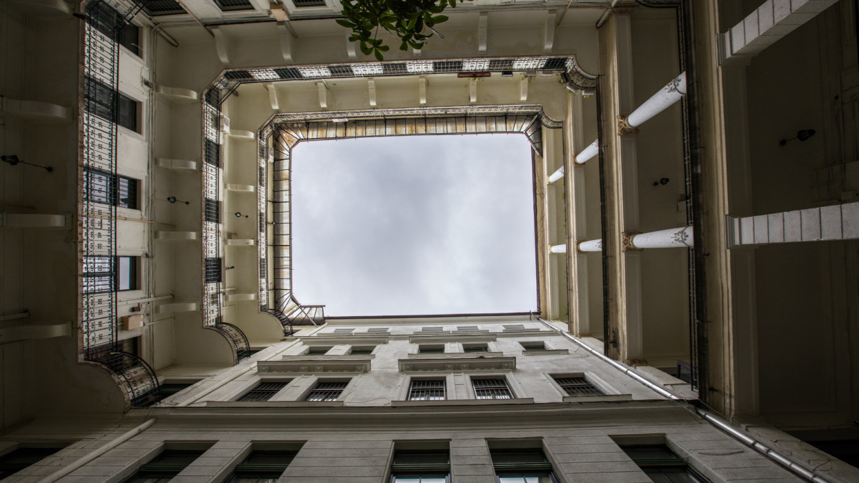 A typical living quarters in the centre of Budapest, the Capital of Hungary in Central Europe.  Looking up at the rectangular format of the building.
