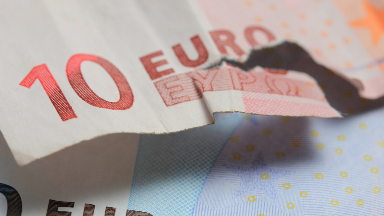 Torn euro note, almost missing the word Euro in Greek characters