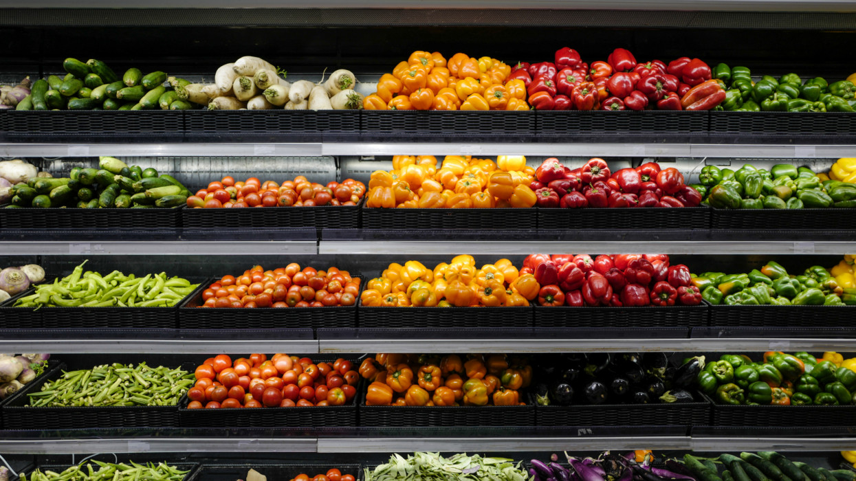 Organic produce in grocery store shelf, Vegetables For Sale In Market.