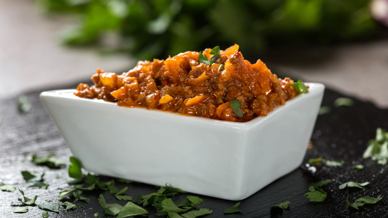 Zacusca - Romanian vegetable spread, with fish, roasted eggplant, onions tomato paste, and roasted red peppers