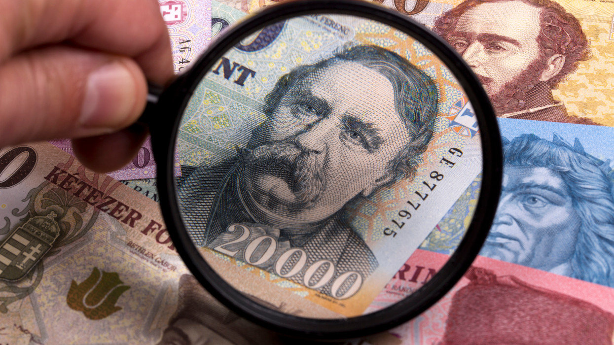 Hungarian forint in a magnifying glass a business background