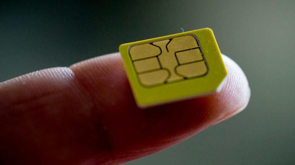 Close-up of a sim crad on a finger